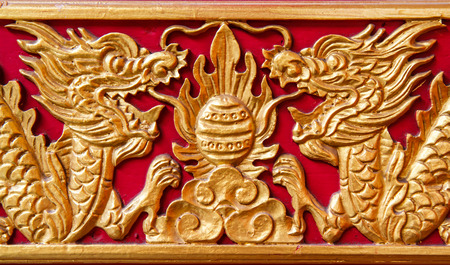 golden dragon decorated on red wood wall,chinese style in temple at Wat-Leng-Noei-Yi2  Bang-Bua-Thong, Nonthaburi, Thailand photo