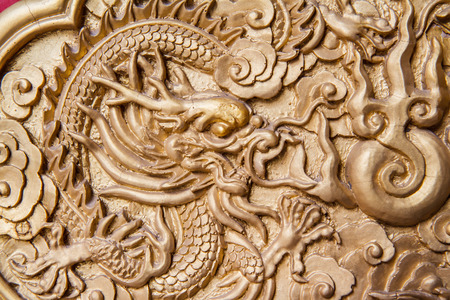 golden dragon decorated on red wood wall,chinese style in temple at Wat-Leng-Noei-Yi2 Bang-Bua-Thong, Nonthaburi, Thailand Stock Photo