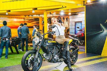 demonstrated: Bangkok, Thailand - April 4, 2015: Booth Ducati presenter demonstrated in 36 Bangkok International Motor Show on April 4, 2015. Editorial