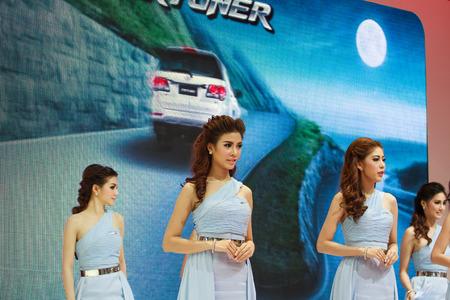 demonstrated: Bangkok, Thailand - April 4, 2015: Toyota booth presenter demonstrated in 36 Bangkok International Motor Show on April 4, 2015.