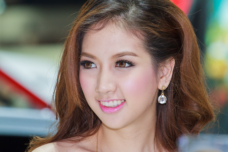 demonstrated: Bangkok, Thailand - April 4, 2015: Chevrolet booth presenter demonstrated in 36 Bangkok International Motor Show on April 4, 2015.