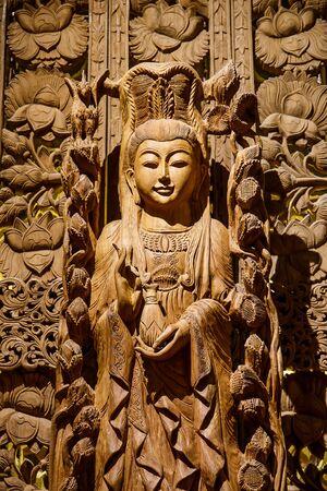 Guan Yin wood carving photo