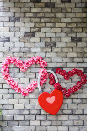 heartshaped: Heart-shaped flowers on a brick wall