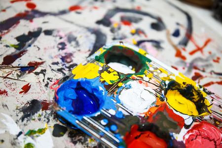paints: Paints and brushes on table