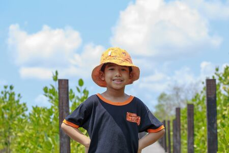 jovial: Portrait of little boy smiling shot on the park