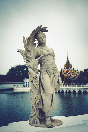 annals: Ayutthaya, Thailand - January 24, 2016: Human sculpture Pa-in Palace, Imperial Palace, also known as the Summer Palace is beautiful, and is one of Thailands major tourist attractions.
