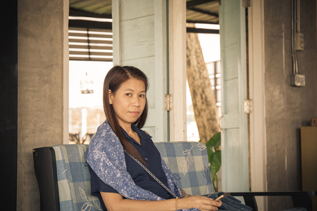 age forty: The living room has a woman Thailand Stock Photo