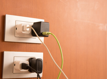 unplugging: Plug the battery charger. Stock Photo