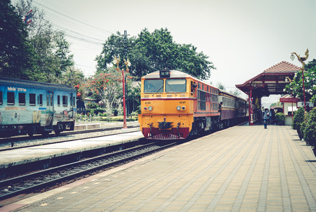wood railroads: HUA HIN,THAILAND - MAY 1,2016 : Hua Hin railway station is a famous place for popular tourist attractions,because its a place to conservation of ancient architecture. Editorial