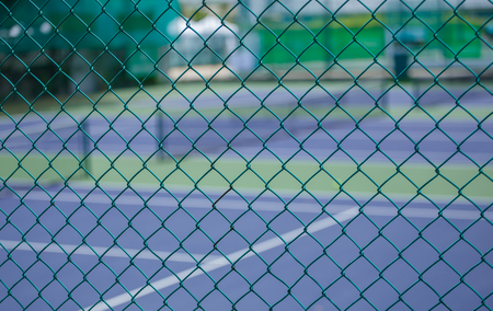 penal system: Steel mesh fence of the tennis courts Stock Photo
