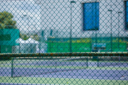 penal system: Steel mesh fence of the tennis courts Editorial