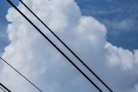 telephone poles: Power lines with sky behind