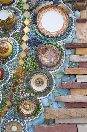 abstract wall made from broken chinaware, tile, mosaic and stone photo