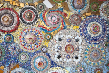 patchwork: abstract wall made from broken chinaware, tile, mosaic and stone
