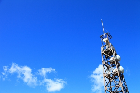 Cell and antenna on blue sky photo