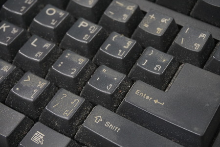 Dusty and dirty keyboard. A close view of some keys on a dirty, black keyboard.