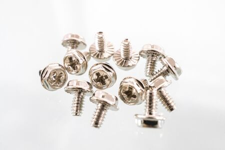 Small computer Screw bolt and nut macro photo on white background. Stock Photo