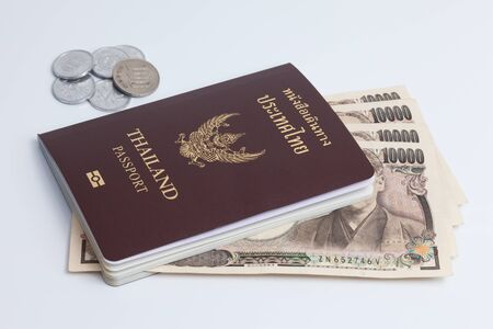 japanese currency: Thai passport with japanese currency. Japanese banknote. Stock Photo