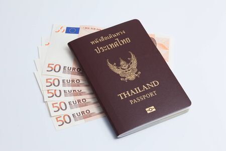 Thai passport with euro currency. Euro banknote. Stock Photo