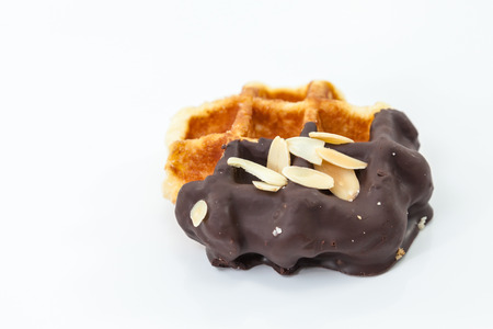 Waffles with chocolate and nut on white background. Stock Photo
