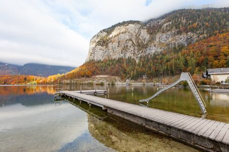 Wooden Jetty in lake at Obertraun city opposite the Hallstatt Austria.Beautiful lake and nature at Obertraun city opposite the Hallstatt Austria.