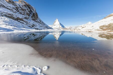 The Matterhorn,Switzerland. View Of Matterhorn In Swiss Alps. Matterhorn with reflection in Riffelsee, Zermatt, Switzerland