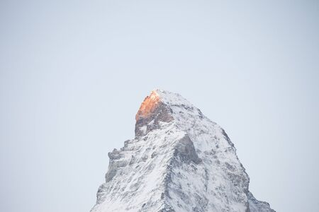 Morning sun over the Matterhorn,Switzerland. View Of Matterhorn In Swiss Alps. Shot from the Zermatt side on a beautifully clear day.