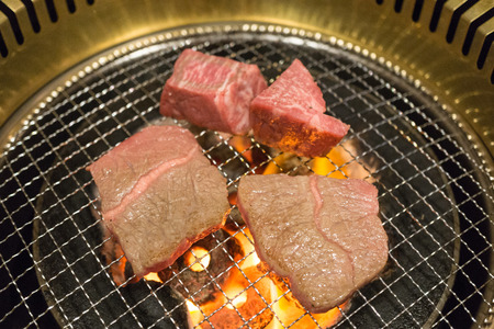 Korean food roasted meat, BBQ grill in korea style. Raw beef grill with charcoal. Stock Photo