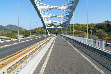 The Shimanami Kaido is a 60 kilometer long toll road that connects Japan's main island of Honshu to the island of Shikoku, passing over six small islands.Cycling is a popular means of experiencing the Shimanami Kaido. The bicycle route is well marked and maintained, and diverges from the expressway on the islands.