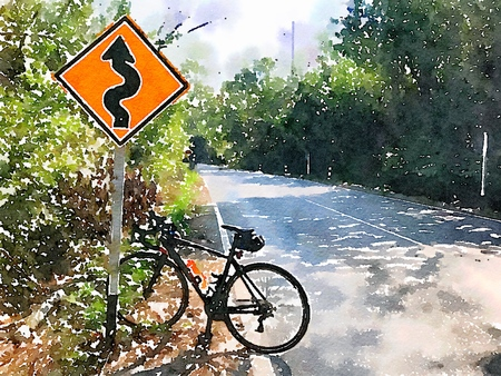 Road bike on hill stand on traffic sign. Simulated to water color paint from photo. Stock Photo