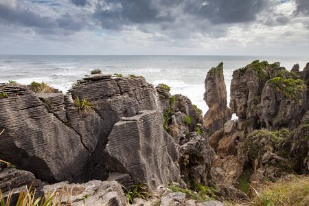 Pancake rocks and blowholes, Punakaiki New zealand. Stock Photo