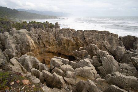 Pancake rocks and blowholes, Punakaiki New zealand. Stock Photo
