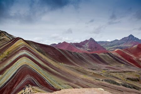 hiking true the beautiful and surreal rainbow mountain range of Cusco, Peru