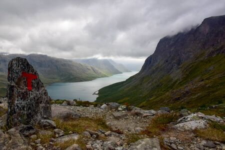 Hiking the Besseggen trail, on a cloudy summer day. Thanks to the hiking trail signs, signpost we found our way back - even with zero sight