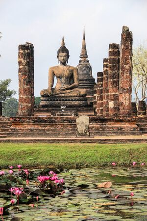 Anient sukothai historical park, Buddhism heritage. Statue reflecting in water