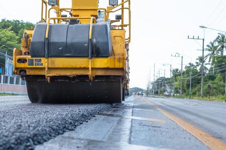 Close-up of asphalt roller working on supplement of asphaltic site