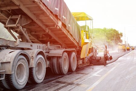 Asphalting  road construction in Thailan. Road machines and Equipments. with sun light