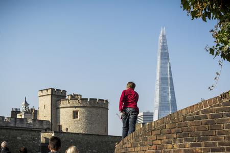 Kid walking towards the Shard in London