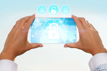 cyber defence: The girl looks at a virtual screen of your smartphone. Text cyber security. Stock Photo