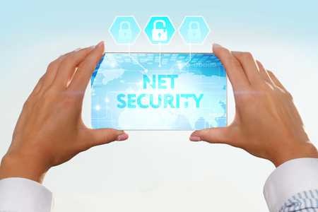 lockout: The girl looks at a virtual screen of your smartphone. Text net security.