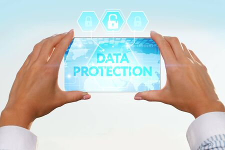 lockout: The girl looks at a virtual screen of your smartphone. Text data protection.