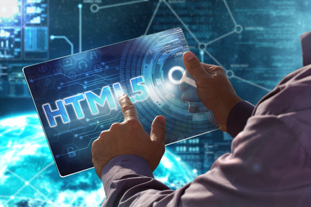 html5: Internet. Business. Technology concept. Businessman presses a button HTML5 on the virtual screen tablet future date.