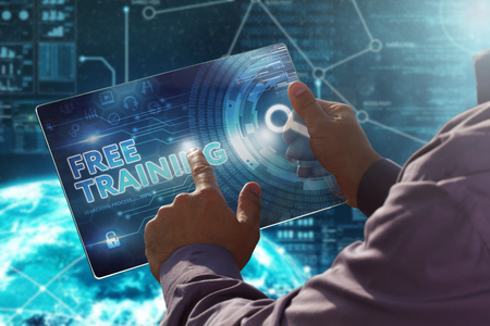 Internet. Business. Technology concept.Businessman presses a button Free Training on the virtual screen tablet future date. 免版税图像
