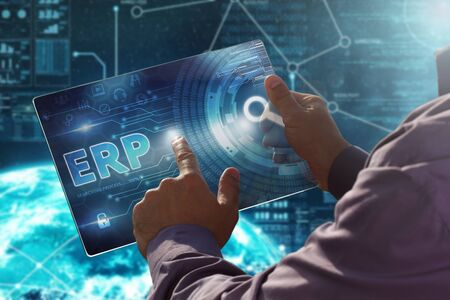 erp: Internet. Business. Technology concept. Businessman presses a button ERP on the virtual screen tablet future date.