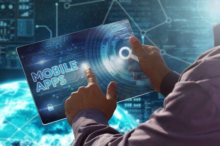 Internet. Business. Technology concept.Businessman presses a button Mobile Apps on the virtual screen tablet future date. Reklamní fotografie