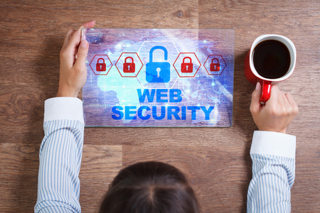 decode: Business, Technology, Internet and network concept. Young business woman with a cup of coffee, working on the tablet of the future, select on the virtual display:  Web security Stock Photo