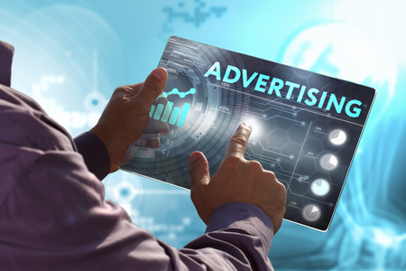 display advertising: Business, Technology, Internet and network concept. Young business man, working on the tablet of the future, select on the virtual display: Advertising