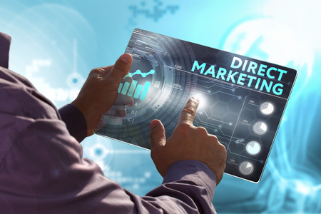 direct marketing: Business, Technology, Internet and network concept. Young business man, working on the tablet of the future, select on the virtual display: Direct marketing