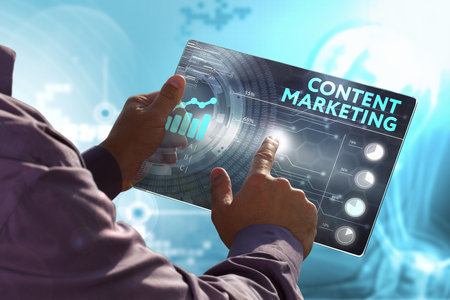 Business, Technology, Internet and network concept. Young business man, working on the tablet of the future, select on the virtual display: content marketing