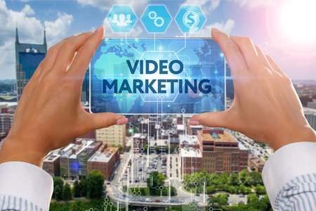 The girl looks at a virtual screen of Smartphone and see the inscription : Video marketing